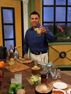 Oscar de la Hoya shows Billy Bush and Kit Hoover his favorite margarita recipe on Access Hollywood Live to celebrate Cinco de Mayo on May 5, 2011