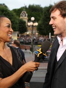 "Access Hollywood's Shaun Robinson and Sam Claflin at the ""Pirates of the Caribbean: On Stranger Tides"" premiere at Disneyland, Anaheim, Calif., May 7, 2011"