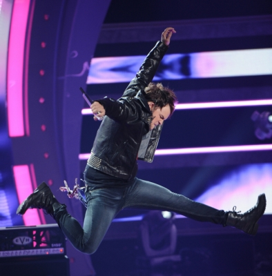 "James Durbin jumps during his performance of ""Love Potion No. 9"" on ""American Idol,"" May 11, 2011"