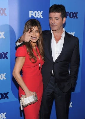 Paula Abdul and Simon Cowell have some fun at the 2011 Fox Upfronts at Wollman Rink - Central Park in New York City on May 16, 2011 
