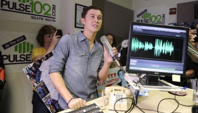 """American Idol"" finalist Scotty McCreery does an interview with a local radio station during his hometown visit in Raleigh, North Carolina"