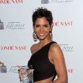 Halle Berry poses with her award backstage at the 2011 FiFi Awards at The Tent at Lincoln Center in New York City on May 25, 2011