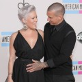 Carey Hart pats wife Pink's pregnant tummy at the 2010 American Music Awards held at Nokia Theatre L.A. Live in Los Angeles on November 21, 2010
