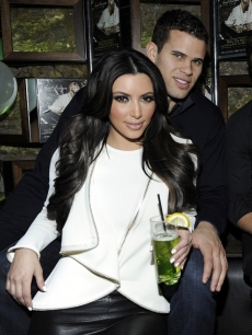 "Kim Kardashian and Kris Humphries cuddle up at the Onitsuka Tiger And RCA Records Present The Release Of Avril Lavigne's ""Goodbye Lullaby"" at SL in New York City on March 8, 2011"