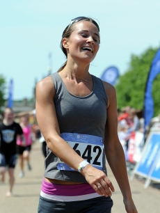 Pippa Middleton reacts after crossing the finish line during the GE Blenheim Triathlon at Blenheim Palace in Woodstock, England, on June 4, 2011