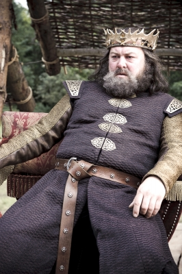 King Robert Baratheon (Mark Addy) watches the tournament for the Hand of the King, &#8220;Game of Thrones,&#8221; HBO, 2011