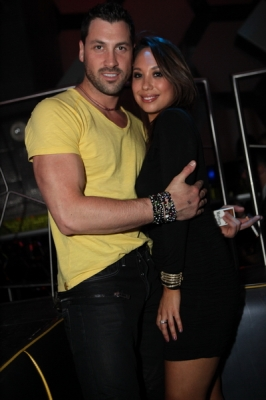 """Dancing With The Stars"" pros Cheryl Burke and Maksim Chmerkovskiy share a hug at Moon Nightclub inside the Palms Casino Resort, Las Vegas, May 28, 2011"