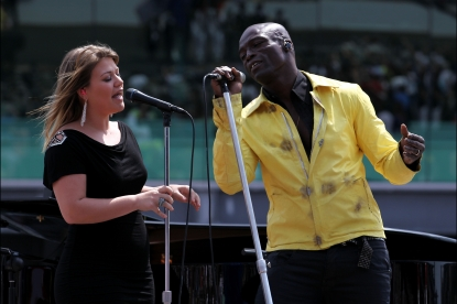 Kelly Clarkson and Seal perform the USA National Anthem prior to the IZOD IndyCar Series Indianapolis 500 Mile Race at Indianapolis Motor Speedway in Indianapolis, Indiana, on May 29, 2011