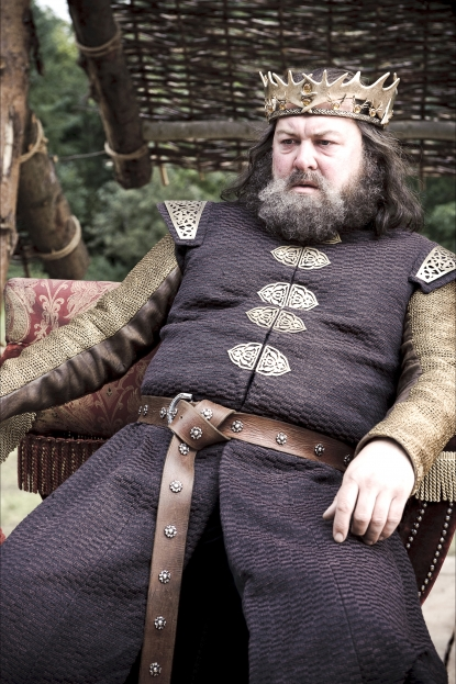 "King Robert Baratheon (Mark Addy) watches the tournament for the Hand of the King, ""Game of Thrones,"" HBO, 2011"