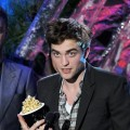 Robert Pattinson accepts the Best Male Performance Award onstage during the 2011 MTV Movie Awards at Universal Studios' Gibson Amphitheatre in Universal City, Calif., on June 5, 2011