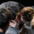 Taylor Lautner and Robert Pattinson share a kiss during the 2011 MTV Movie Awards at Universal Studios' Gibson Amphitheatre in Universal City, Calif. on June 5, 2011