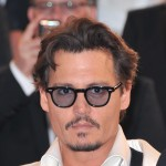 "Johnny Depp departs the ""Pirates of the Caribbean: On Stranger Tides"" premiere during the 64th Annual Cannes Film Festival at Palais des Festivals on May 14, 2011 in Cannes, France"