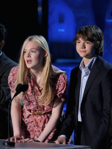 J.J. Abrams, Elle Fanning, Joel Courtney, and Steven Spielberg onstage during the 2011 MTV Movie Awards at Universal Studios' Gibson Amphitheatre in Universal City, Calif. on June 5, 2011