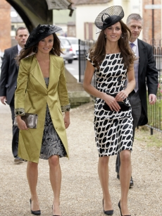 Pippa Middleton and Catherine, Duchess of Cambridge attend the wedding of Sam Waley-Cohen and Annabel Ballin at St. Michael and All Angels church in Lambourn, England, on June 11, 2011