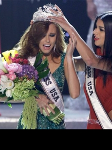 Alyssa Campanella, Miss California, is crowned as the 2011 Miss USA by Miss USA 2010 Rima Fakih in Las Vegas on June 19, 2011