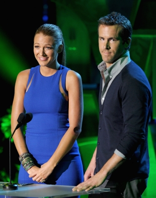 Blake Lively and Ryan Reynolds present an award onstage during the 2011 MTV Movie Awards at Universal Studios' Gibson Amphitheatre in Universal City, Calif., on June 5, 2011