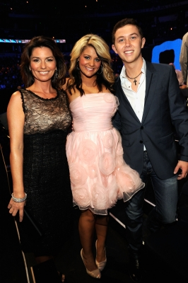 Shania Twain, Lauren Alaina, and Scotty McCreery pose backstage at the 2011 CMT Music Awards at the Bridgestone Arena, Nashville, on June 8, 2011