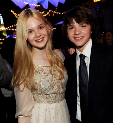 "Elle Fanning and Joel Courtney step out at the ""Super 8"" premiere in Westwood, Calif. on June 8, 2011"