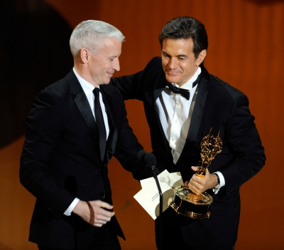 Dr. Mehmet Oz accepts the Outstanding Talk Show Host award from journalist Anderson Cooper onstage during the 38th Annual Daytime Entertainment Emmy Awards held at the Las Vegas Hilton in Las Vegas on June 19, 2011
