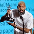 Chris Brown accepts the Best Male R&B Artist award onstage during the BET Awards '11 held at the Shrine Auditorium in Los Angeles on June 26, 2011