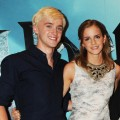 Tom Felton and Emma Watson smile during a photocall for 'Harry Potter And The Half-Blood Prince' at Claridge's Hotel in London on July 6, 2009