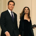 Arnold Schwarzenegger and wife Maria Shriver arrive for a black-tie dinner at the White House on February 22, 2009 in Washington, DC
