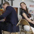 Catherine, Duchess of Cambridge, smiles at her husband, Prince William, while the couple paints at Inner City Arts in Los Angeles on July 10, 2011
