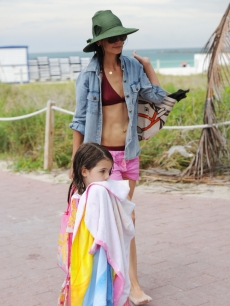 Katie Holmes (R) and Suri Cruise are sighted on South Beach on June 18, 2011 in Miami Beach, Fla.
