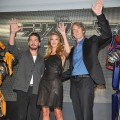 Shia LaBeouf, Rosie Huntington-Whiteley and Michael Bay wave to fans at the 'Transformers: Dark of the Moon' stage greeting at Osaka Station City Cinema in Osaka, Japan, on July 16, 2011