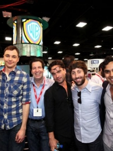 """The Big Bang Theory"" cast poses with Warner Bros. Television President Peter Roth at the Warner Bros. Comic-Con booth in San Diego, Calif., on July 22, 2011"
