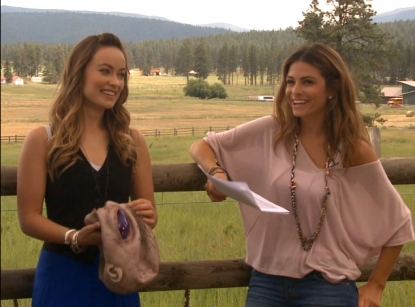 "Olivia Wilde chats with Access Hollywood's Maria Menounos at the ""Cowboys & Aliens"" junket in Montana, July 2011"