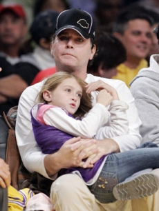 Ray Liotta and daughter Karsen take in the game too