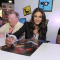 Emmanuelle Chriqui, who voices Cheetara, signs posters at a &#8220;Thundercats&#8221; event