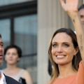 Brad Pitt and Angelina Jolie wave to fans on the red carpet before attending the closing ceremony of the 17th Sarajevo Film Festival  at the national theater in downtown Sarajevo on July 30, 2011