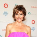 Lisa Rinna smiles at QVC Presents Super Saturday Live at Nova's Art Project in Water Mill, New York, on July 30, 2011