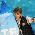 Justin Bieber accepts the Choice Male Artist award onstage during the 2011 Teen Choice Awards held at the Gibson Amphitheatre in Universal City, Calif. on August 7, 2011