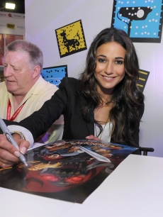 "Emmanuelle Chriqui, who voices Cheetara, signs posters at a ""Thundercats"" event"
