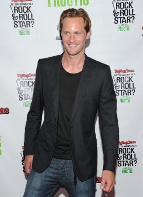 "Alexander Skarsgard is all smiles at Rolling Stone's ""Do You Wanna Be a Rock & Roll Star?"" cover reveal party at the Empire Hotel Rooftop in New York City on August 3, 2011"