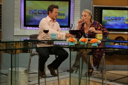 """Cougar Town's'"" Busy Philipps enjoys a little taste of Big Carl II's contents as she co-hosts Access Hollywood Live with Billy Bush, July 28, 2011"