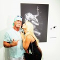 Hulk Hogan and Brooke Hogan attend Brooke Hogan's portrait unveiling at Women In cages exhibit at Cafeina Lounge in Miami, Flor., on August 11, 2011