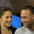 Minka Kelly and Derek Jeter of the New York Yanklees watch as Novak Djokovic of Serbia plays against James Blake of the United States during his men's singles match on day six of the 2010 U.S. Open at the USTA Billie Jean King National Tennis Center on September 4, 2010 in the Flushing neighborhood of the Queens borough of New York City on September 4, 2010