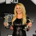 Britney Spears poses with her awards in the press room during the 2011 MTV Video Music Awards at Nokia Theatre L.A. LIVE in Los Angeles on August 28, 2011