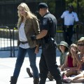 Police officers arrest American actress Daryl Hannah during a protest against the construction of the Keystone XL pipeline, outside the White House in Washington, DC, August 30, 2011