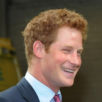 Prince Harry visits Salford Ambulance Headquarters to meet ambulance crew members who were on duty during last week's riots in Salford, England on August 18, 2011