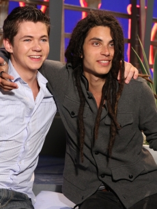 """The Glee Project"" winners Damian McGinty and Samuel Larsen share a hug on the set of Access Hollywood Live on August 22, 2011"