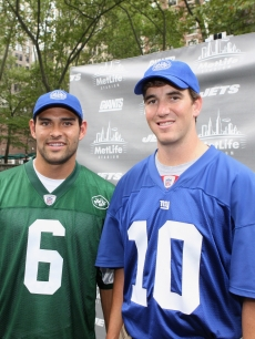 New York Jets quarterback Mark Sanchez and New York Giants quaterback Eli Manning pose during the MetLife Stadium celebration in Bryant Park, NYC, on August 26, 2011