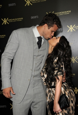 Kris Humphries and Kim Kardashian share a kiss on the red carpet of the Kardashian Kollection Launch Party in Hollywood, Calif.on August 17, 2011