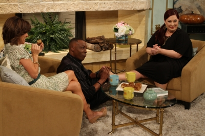 Arsenio Hall gives Carnie Wilson a foot rub during her interview on Access Hollywood Live on August 25, 2011