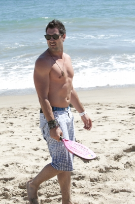 "A shirtless Maksim Chmerkovskiy of ""Dancing with the Stars"" hits the beach at the Just Dance 3 Beachfront BBQ Preview Party, Malibu, Aug. 25, 2011"