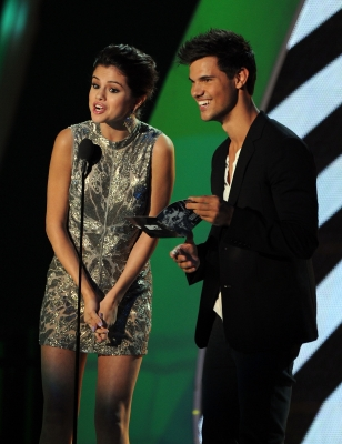 Selena Gomez and Taylor Lautner speak onstage during the 2011 MTV Video Music Awards at Nokia Theatre L.A. LIVE in Los Angeles, on August 28, 2011 